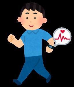 活動量計をつけて歩く男性