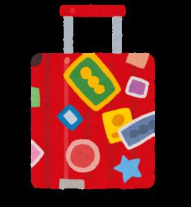シールが貼られたスーツケース