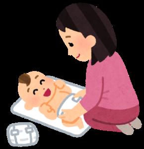 赤ちゃんのオムツを替えるお母さん