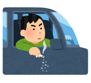 車からタバコの灰を落とす人