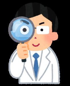 虫眼鏡を持つ医者