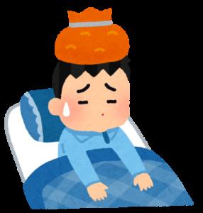 風邪で寝込む男性
