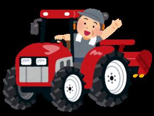 トラクターを運転する男性