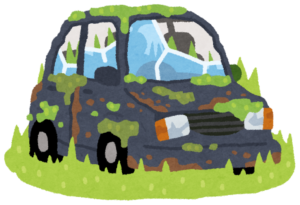 草むらに放置された自動車